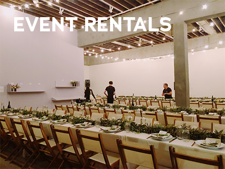 A group of people setting up an evenet with the text Event Rentals